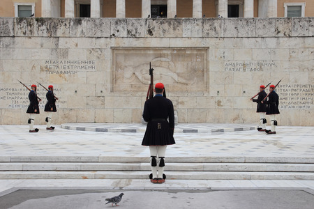 syntagma: ATHENS, GREECE - MARCH 23, 2015: Every Sunday morning at 11 am, people gather in Syntagma Square to watch the official changing of the guards in front of the Parliament Building