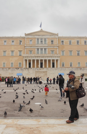 syntagma: ATHENS, GREECE - MARCH 23, 2015: Sunday morning in Syntagma Square, people wait the official changing of the guards in front of the Parliament Building