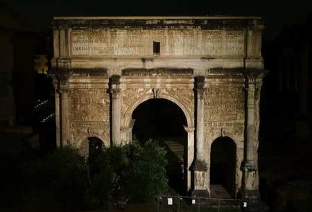 severus: Arch of Septimius Severus at night in Rome, Italy Stock Photo