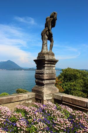 bella: statue view of Isola Bella on Maggiore lake, Italy