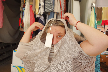 pricetag: woman buying at market, empty price-tag on dress