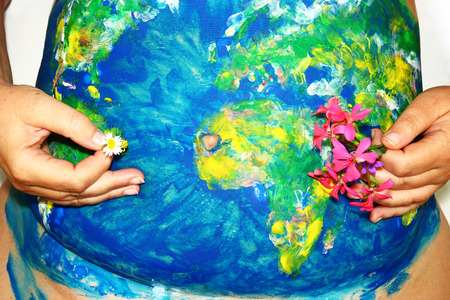 body paint: Earth Mother concept, globe body paint on a female pregnant belly Stock Photo
