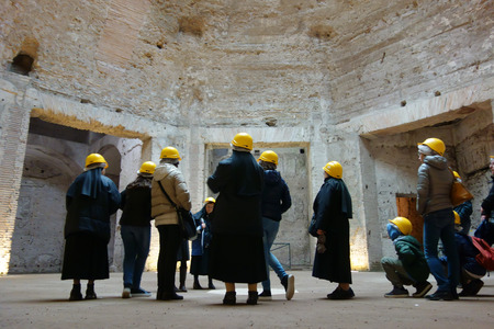 Visitors in the octogonal room of the Domus Aurea, the famous  Nero palace on the slopes of the Esquiline hill
