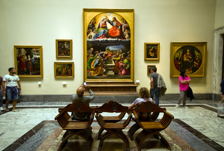 classicism: VATICAN CITY, VATICAN STATE - SEPTEMBER 27, 2015: People under the Giulio Romano painting the Coronation of the Virgin aka Madonna of Monteluce 16th-century renaissance classicism, Vatican Museums
