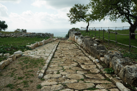 pontine: Ancient roman road in Norba on the Volscian mountains, overlooking the Pontine Marshes, Italy