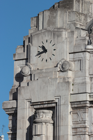 Modernist watch of the Central railway station in Milan ,Italy