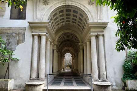 forced perspective: ROME, ITALY - MAY 1, 2016: Palazzo Spada the forced perspective gallery by Francesco Borromini. The baroque corridor is only nine metres long, but looks much longer