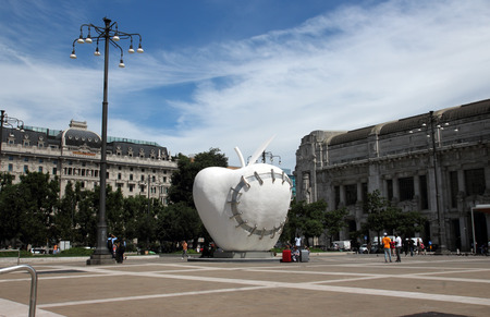michelangelo: MILAN, ITALY - JUNE 27, 2016: the monumental sculpture La Mela Reintegrata (The Reintegrated Apple) by Michelangelo Pistoletto in front of the central station