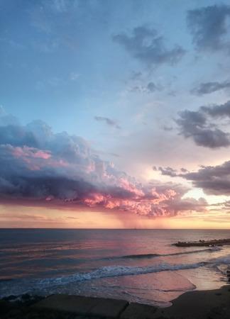 cloudscape above sunset Tyrrhenian sea, Anzio, Italy