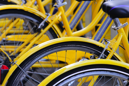 detail of yellow bicycles at parking area, urban transportation concept Stok Fotoğraf
