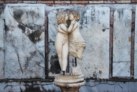 cupido: OSTIA ANTCA, ITALY -  JULY  2, 2017: Ancient Roman statue in Ostia town, Cupido and Psyche kissing, 2nd century AD. Room E of the House of Cupid and Psyche