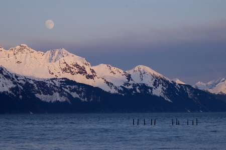 Moonrise over Alaskan Mountain Range Stock Photo