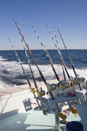 Fighting Chair and Fishing Rodds on Charter Fishing Boat Stock Photo