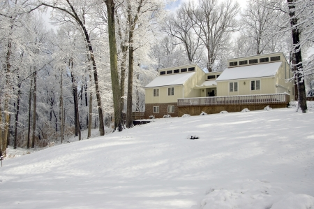 Cozy Home on Snow Covered Hillside Stock Photo - 16681224