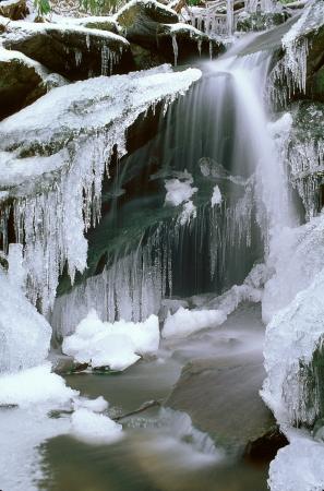 Small frozen waterfall with icycles Stock Photo - 17034391