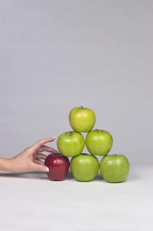 Woman Selecting an dApple from Stack 스톡 콘텐츠