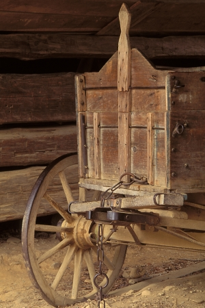 An old wooden wagon with spokes wooden wheels photo