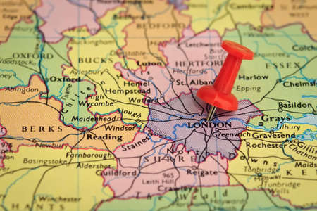 push pins: Destination London - Map pin stuck into a map of London
