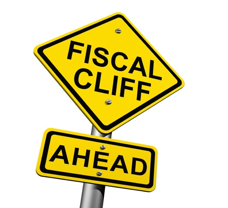 Road sign indicating fiscal cliff ahead Stock Photo