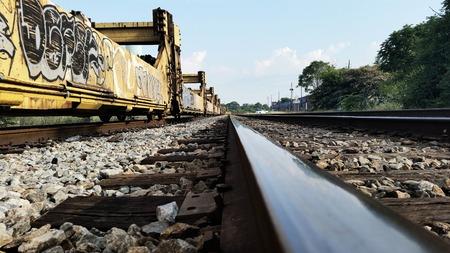 Eye Level on Tracks Graffiti on Train Cars Railroad Stock Photo