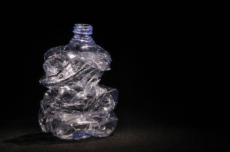 Plastic bottle on black background