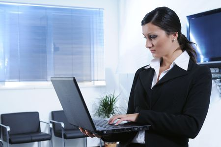 young businesswoman uses laptop with wireless mode