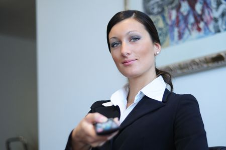woman, to make use of remote control TV