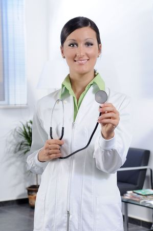 farmacy: young doctor with stethoscope smiles and look in camera