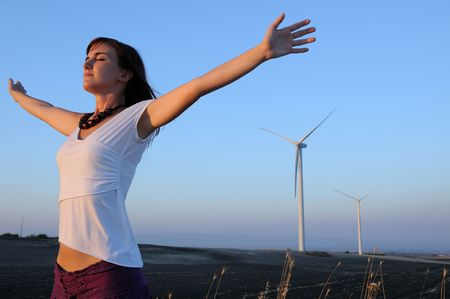 woman and wind turbines,energy and relax.