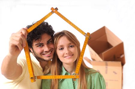 young couple purchase new home, happiness and look in camera Stock Photo