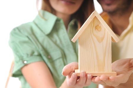 young couple and little home in the hands
