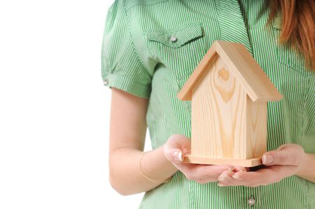 little home in the hands of young woman, on the white background