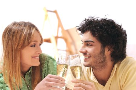young couple purchase new home, to toast with fizzy photo