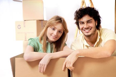 young couple purchase new home, smile and look in camera photo