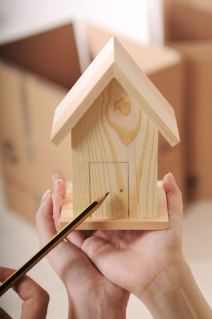 young couple purchase new home, hands and little house Stock Photo