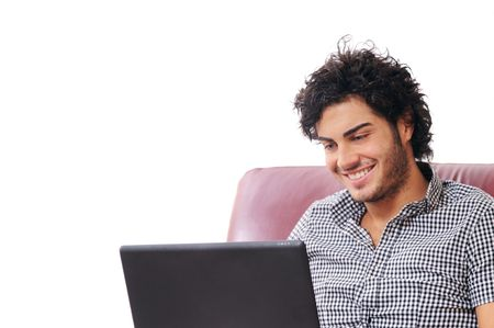 a young man  using laptop, happiness and amazement Stock Photo