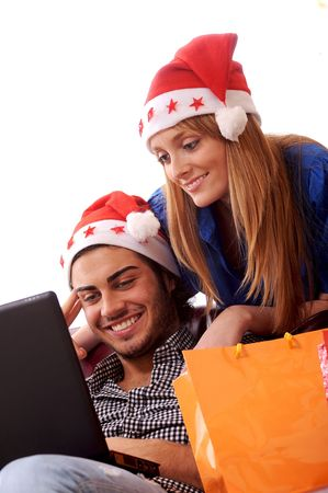 Boy and girl in Christmas on-line shopping on white background