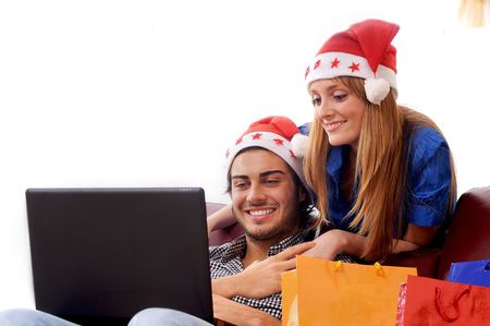 young couple in Christmas on-line shopping on white background photo