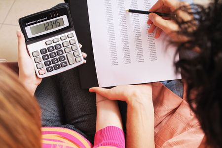 couple and savings, to write and to calculate together photo