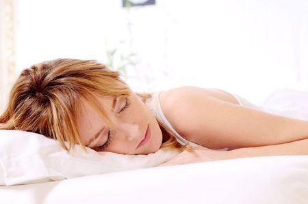 beautiful woman sleep on the white background