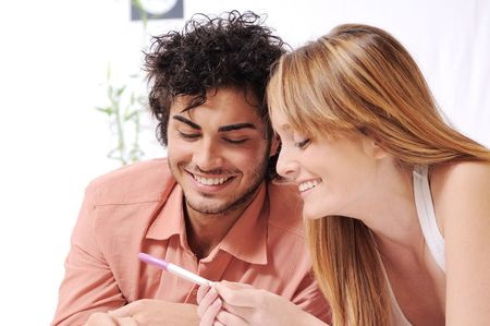 young couple smiling for pregnancy test, parental and couple love