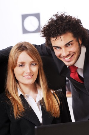 worker couple uses laptop in the office photo