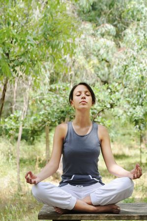 young woman in green forest, yoga and meditation  Stock Photo