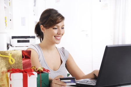 happy shopping online of young woman with laptop on internet Stock Photo