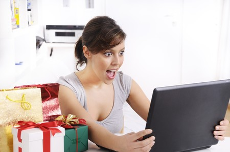 happy shopping online of young woman with laptop on internet, concept of amazement Stock Photo