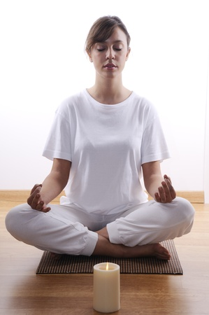 meditaion: yoga and meditaion of young woman in indoor