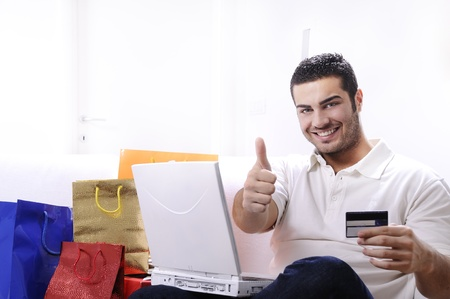 young man buying on internet with laptop in indoor Stock Photo - 9226203