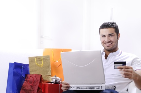 young man buying on internet with laptop in indoor Stock Photo - 9226190