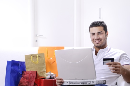 young man buying on internet with laptop in indoor Stock Photo - 9226202