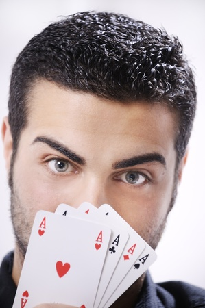 man with ace poker; four aces in hands; smiling and looking in camera. photo